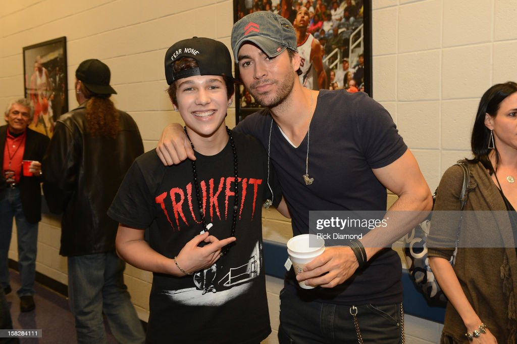 Austin Mahone and Enrique Iglesias pose backstage at Power 96.1's Jingle Ball 2012 at the Philips Arena on December 12, 2012 in Atlanta.