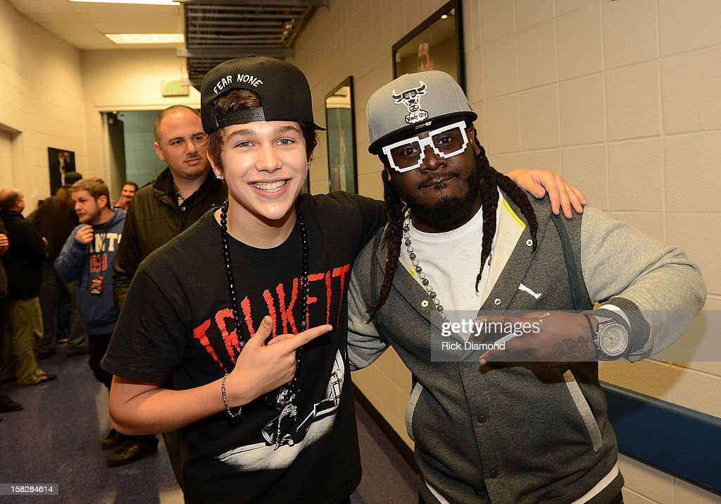 Austin Mahone and T-Pain pose backstage at Power 96.1's Jingle Ball 2012 at the Philips Arena on December 12, 2012 in Atlanta.