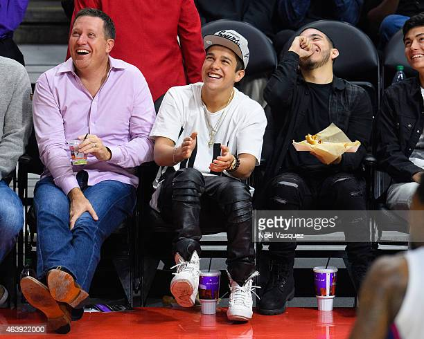 Austin Mahone attends a basketball game between San Antonio Spurs and the Los Angeles Clippers at Staples Center on February 19 2015 in Los Angeles...