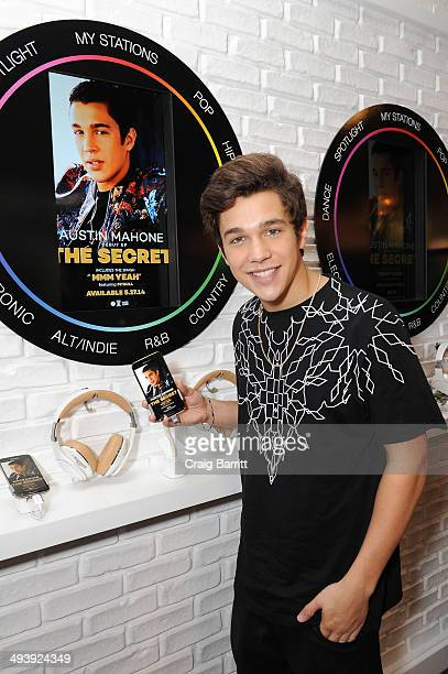 Austin Mahone checks out the Milk Music listening station at Samsung Galaxy Soho Studio on May 26 2014 in New York City