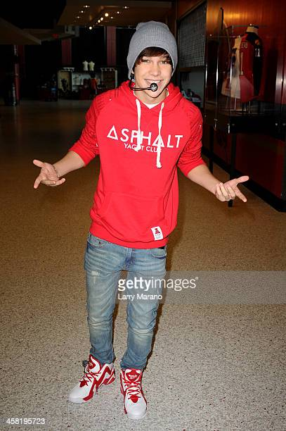Austin Mahone performs at Y100's PreShow at the Jingle Ball Village on the plaza at the BBT Center on December 20 2013 in Miami Florida