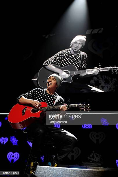 Austin Mahone performs onstage during Y100's Jingle Ball 2013 Presented by Jam Audio Collection at BBT Center on December 20 2013 in Miami Florida