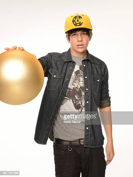 Austin Mahone poses for a portrait backstage at the Kiss FM's Jingle Ball 2013 at Staples Center on December 6 2013 in Los Angeles California