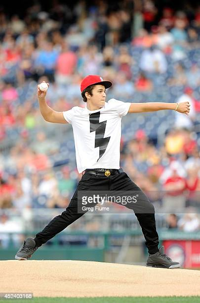 Austin Mahone throws out the first pitch before the game between the Washington Nationals and the Milwaukee Brewers at Nationals Park on July 19 2014...