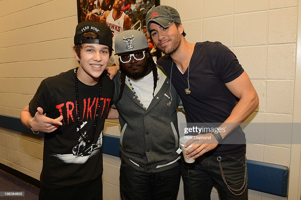 Austin Mahone, T-Pain and Enrique Iglesias pose backstage at Power 96.1's Jingle Ball 2012 at the Philips Arena on December 12, 2012 in Atlanta.