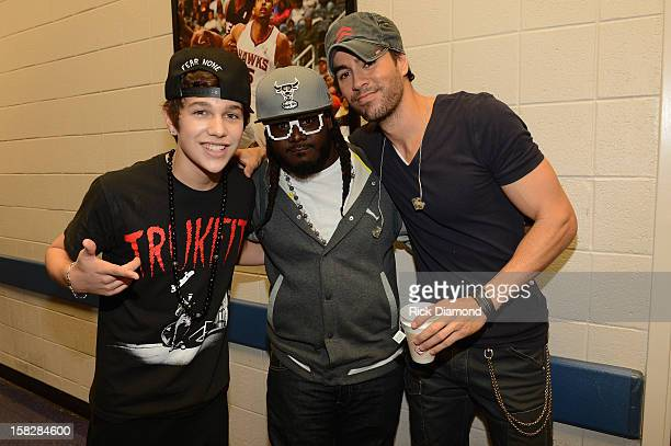 Austin Mahone TPain and Enrique Iglesias pose backstage at Power 961's Jingle Ball 2012 at the Philips Arena on December 12 2012 in Atlanta