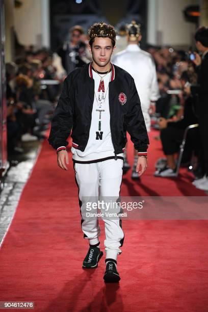 Austin Mahone walks the runway at the Dolce Gabbana Unexpected Show during Milan Men's Fashion Week Fall/Winter 2018/19 on January 13 2018 in Milan...