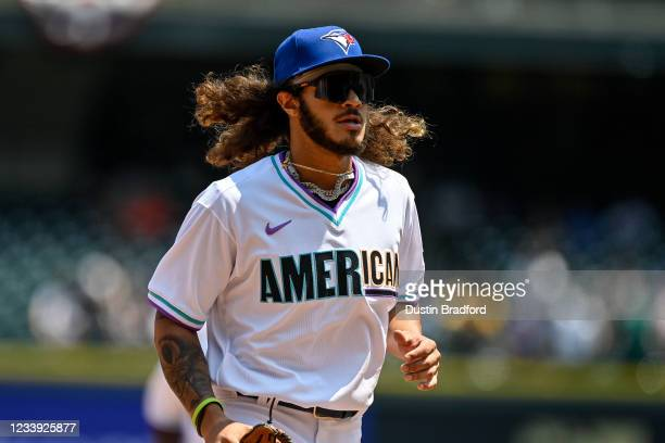 Austin Martin of American League Futures Team runs on the field as players warm up before the game against the National League Futures Team at Coors...