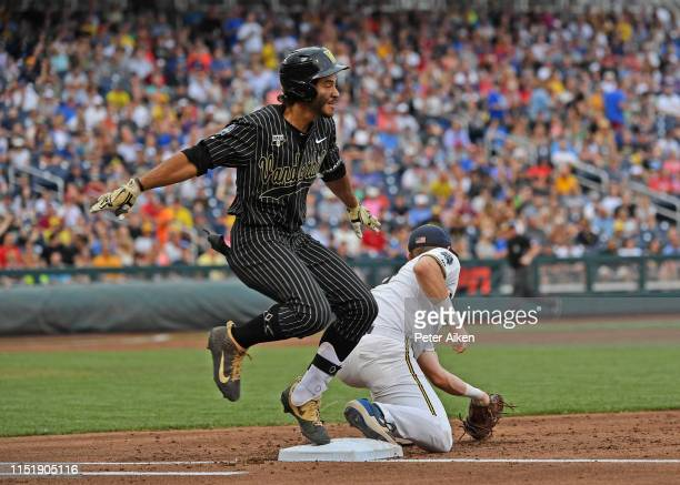 Austin Martin of the Vanderbilt Commodores gets thrown out at first base in the third inning against the Michigan Wolverines during game two of the...