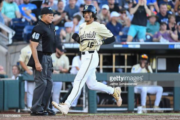 Austin Martin of the Vanderbilt Commodores scores a run against the Michigan Wolverines during the Division I Men's Baseball Championship held at TD...