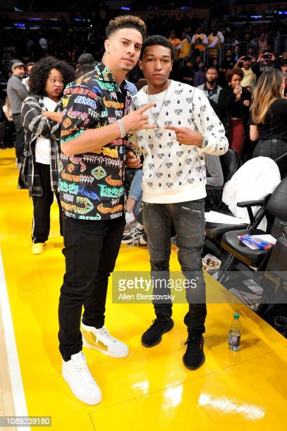 Austin McBroom and Koraun Mayweather attend a basketball game between the Los Angeles Lakers and the Oklahoma City Thunder at Staples Center on...
