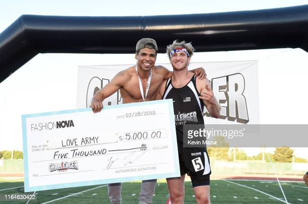 Austin McBroom and Logan Paul attend The Challenger Games Inaugural Celebrity Charity Track Field Competition at Veterans Memorial Stadium on July 27...