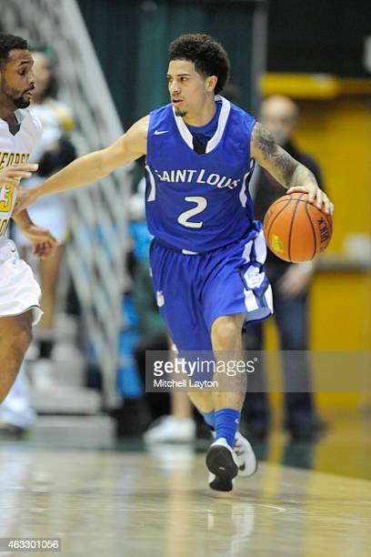 Austin McBroom of the Saint Louis Billikens dribbles the ball during a college basketball game against the George Mason Patriots at the Patriot...