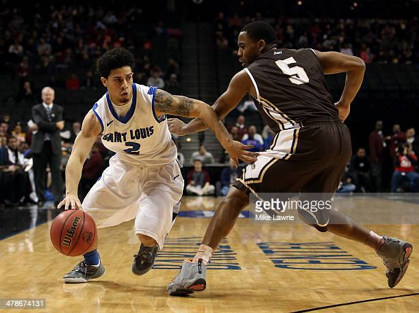 Austin McBroom of the Saint Louis Billikens drives with the ball against Jordan Gathers of the St Bonaventure Bonnies in the first half during the...