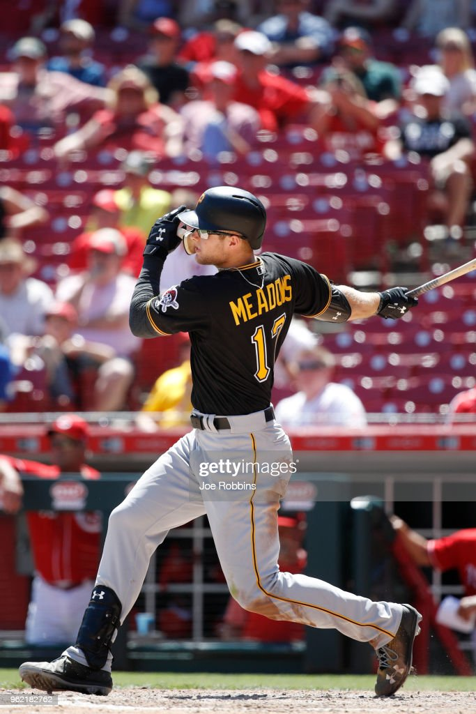 Austin Meadows #17 of the Pittsburgh Pirates hits a two-run home run in the ninth inning against the Cincinnati Reds at Great American Ball Park on May 24, 2018 in Cincinnati, Ohio. The Reds won 5-4.