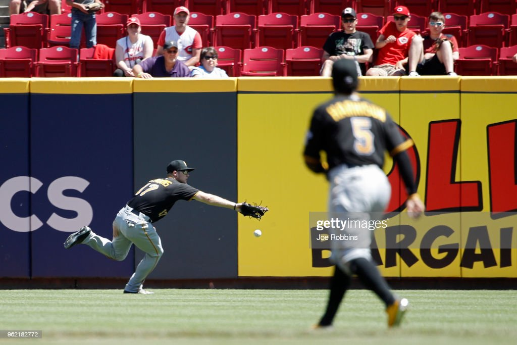 Austin Meadows #17 of the Pittsburgh Pirates is unable to catch a ball hit by Brandon Dixon of the Cincinnati Reds in the eighth inning at Great American Ball Park on May 24, 2018 in Cincinnati, Ohio. The Reds won 5-4.