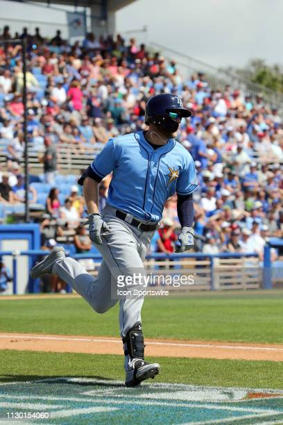 Austin Meadows of the Rays hustles down to first base during the spring training game between the Tampa Bay Rays and the Toronto Blue Jays on March...