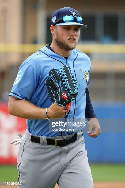 Austin Meadows of the Rays trots off the field during the spring training game between the Tampa Bay Rays and the Toronto Blue Jays on March 12 at...