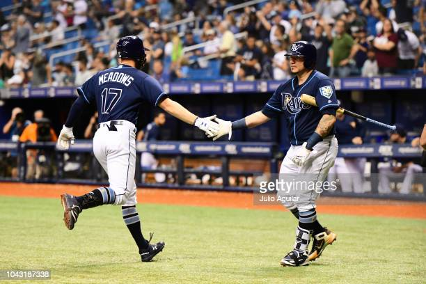 Austin Meadows of the Tampa Bay Rays celebrates with Andrew Velazquez after hitting a home run in the seventh inning against the Toronto Blue Jays on...