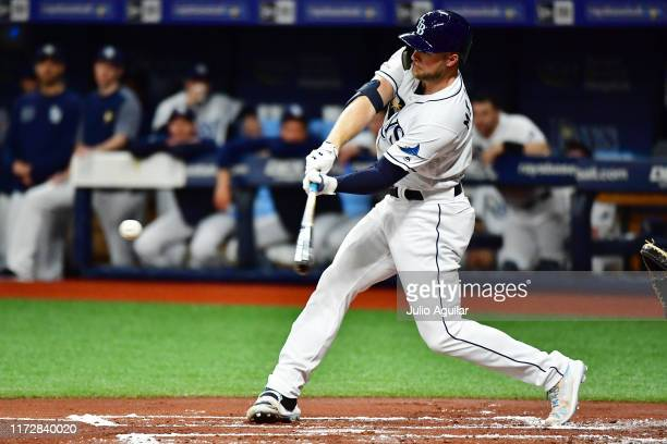 Austin Meadows of the Tampa Bay Rays hits a single off Clay Buchholz of the Toronto Blue Jays in the first inning of a baseball game at Tropicana...