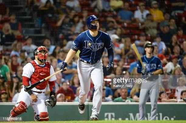 Austin Meadows of the Tampa Bay Rays hits a solo home run in the ninth inning against the Boston Red Sox at Fenway Park on August 1 2019 in Boston...