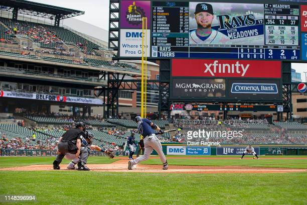 Austin Meadows of the Tampa Bay Rays hits an RBI single in the first inning during a MLB game against the Detroit Tigers at Comerica Park on June 6...
