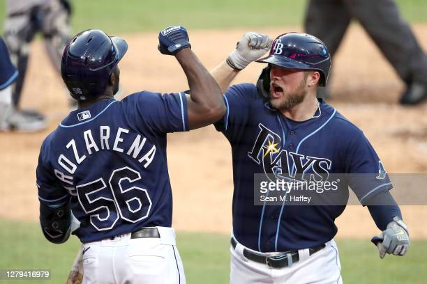 Austin Meadows of the Tampa Bay Rays is congratulated by Randy Arozarena after hitting a solo home run against the New York Yankees during the fifth...
