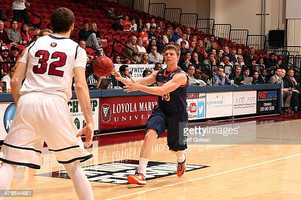 Austin Mills of the Pepperdine Waves delivers a nolook pass against Gabe Levin of the Loyola Marymount Lions in the first half of the game at Gersten...