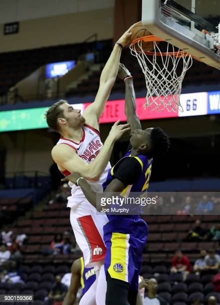 Austin Nichols of the Memphis Hustle dunks against Chris Boucher of the Santa Cruz Warriors during an NBA GLeague game on March 10 2018 at Landers...