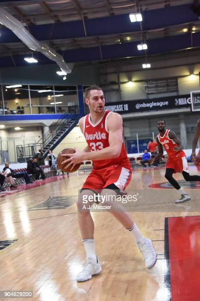 Austin Nichols of the Memphis Hustle handles the ball during the NBA GLeague Showcase Game 25 between the Memphis Hustle and the Maine Red Claws on...