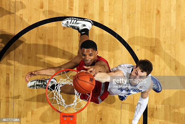 Austin Nichols of the Memphis Tigers jumps for a rebound against Jeremy Watson of the Jacksonville State Gamecocks on February 4 2015 at FedExForum...