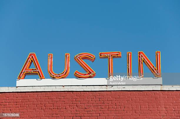 austin orange neon sign - austin texas stock pictures, royalty-free photos & images