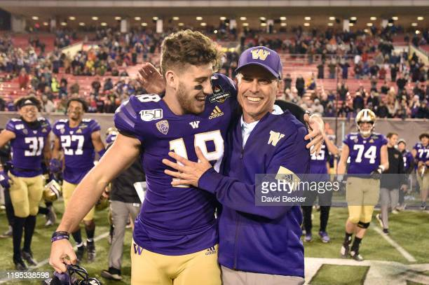Austin Osborne and head coach Chris Petersen of the Washington Huskies celebrate after defeating the Boise State Broncos 387 in the Mitsubishi Motors...