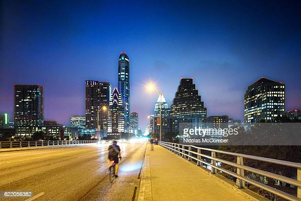 austin panorama at night on congess avenue bridge - austin texas stock pictures, royalty-free photos & images