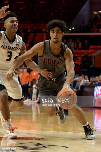 Austin Peay Governors Guard Dayton Gumm dribbles by Illinois Fighting Illini guard Te'Jon Lucas during the college basketball game between the Austin...