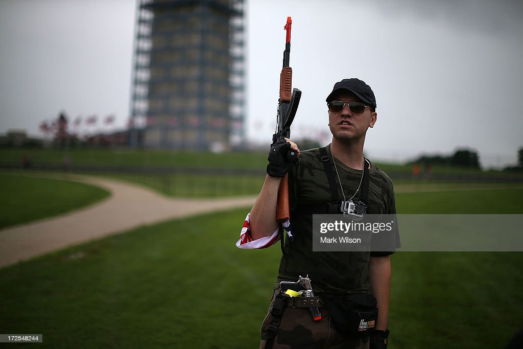 Austin Petersen holds a toy gun during a rally on the grounds of the Washington Monument July 3, 2013 in Washington, DC. Gun rights advocates participates in the Armed Toy Gun March on D.C. to raise money and toys for the Toys for Tots program.