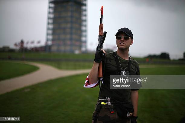 Austin Petersen holds a toy gun during a rally on the grounds of the Washington Monument July 3 2013 in Washington DC Gun rights advocates...