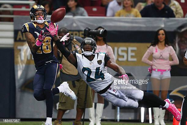 Austin Pettis of the St Louis Rams catches a touchdown pass against Will Blackmon of the Jacksonville Jaguars at the Edward Jones Dome on October 6...