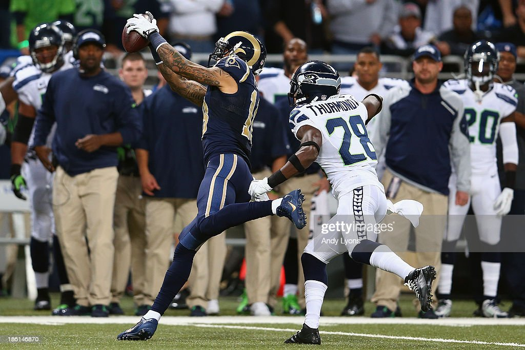Austin Pettis #18 of the St. Louis Rams makes a catch against Walter Thurmond #28 of the Seattle Seahawks during an NFL game at Edward Jones Dome on October 28, 2013 in St Louis, Missouri.