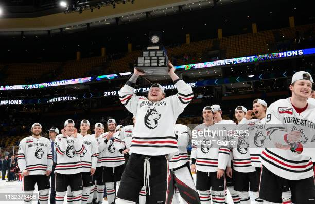 Austin Plevy of the Northeastern Huskies celebrates a 3-2 victory against the Boston College Eagles after NCAA hockey in the Hockey East Championship...