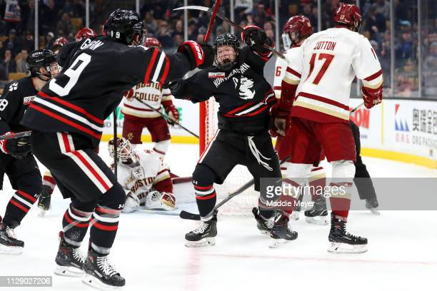 Austin Plevy of the Northeastern Huskies celebrates with Tyler Madden after scoring a goal against the Boston College Eagles during the 2018 Beanpot...