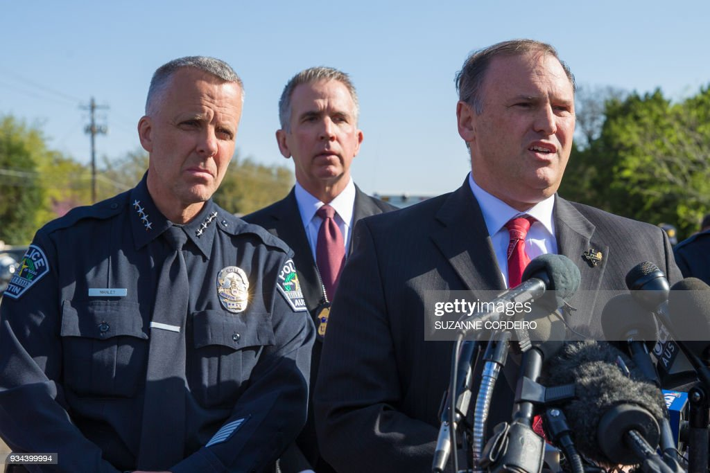 Austin Police Chief Brian Manley(L), ATF Special Agent in Charge Fred Milanowski, and FBI Agent Christopher Combs brief reporters during a press conference on March 19, 2018, in Austin, Texas. Police and bomb experts are investigating a fourth mysterious bombing this month in the Texas state capital of Austin, a blast that injured two young men in their twenties. The explosion came just hours after police made a direct public appeal to the person or persons who carried out the previous bombings to come forward. So far, they have claimed the lives of two people and injured four others. /