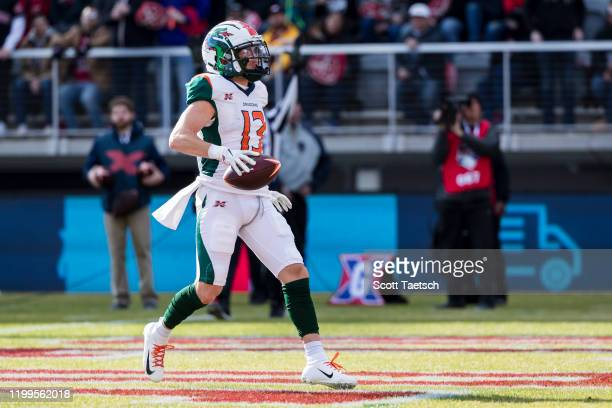 Austin Proehl of the Seattle Dragons scores the first touchdown in the history of the resurrected XFL during the first half of the game against the...
