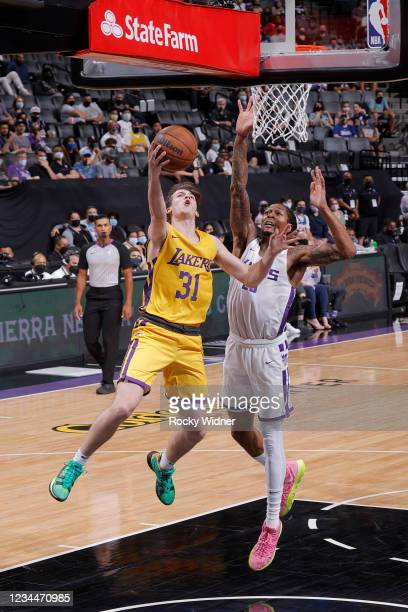 Austin Reaves of the Los Angeles Lakers drives to the basket against the Sacramento Kings during the 2021 California Classic Summer League on August...