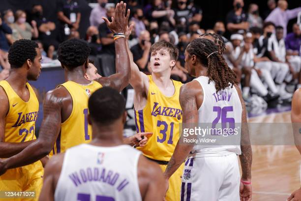 Austin Reaves of the Los Angeles Lakers high fives Devontae Cacok of the Los Angeles Lakers during the 2021 California Classic Summer League on...