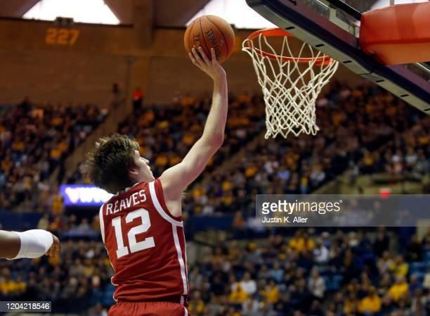 Austin Reaves of the Oklahoma Sooners lays one in against the West Virginia Mountaineers at the WVU Coliseum on February 29 2020 in Morgantown West...