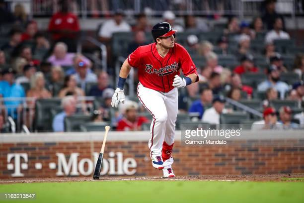Austin Riley of the Atlanta Braves bats during the game against the Washington Nationals at SunTrust Park on July 19 2019 in Atlanta Georgia
