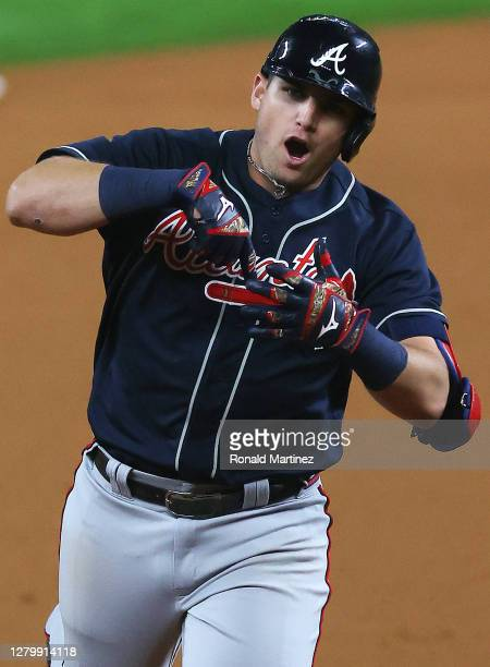 Austin Riley of the Atlanta Braves celebrates a solo home run against the Los Angeles Dodgers during the ninth inning in Game One of the National...