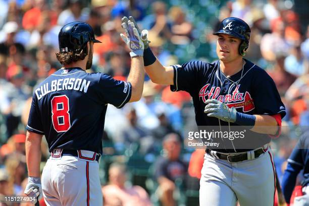Austin Riley of the Atlanta Braves celebrates a two run home run with Charlie Culberson during the eighth inning against the San Francisco Giants at...