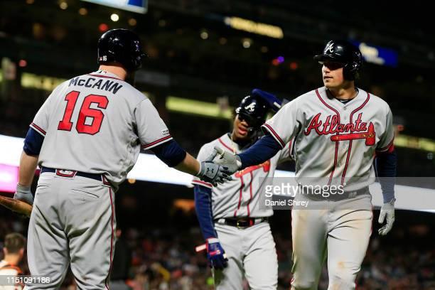 Austin Riley of the Atlanta Braves celebrates hitting a three run home run with Brian McCann during the seventh inning against the San Francisco...